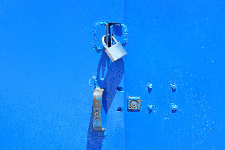 A blue door background with an industrially soldered clasp for the lock to secure the door nicely, representing website security